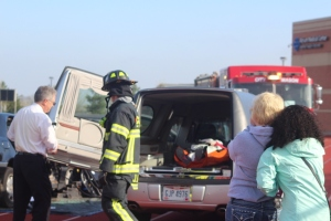 Annie Jones and I stand by as Leah Hall is put into a funeral home vehicle during Mock Crash.